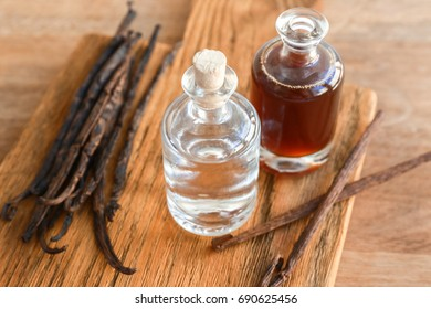 Ingredients for homemade vanilla extract on wooden board