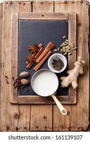 Ingredients for Indian masala tea on background of slate