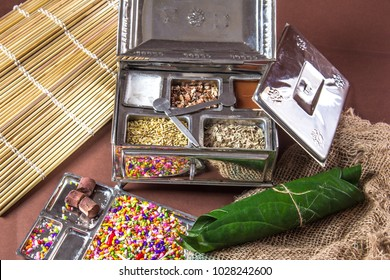 Ingredients of indian traditional digestive meetha masala paan which is a mouth freshener and digestive. Sauf, tutti frutti, supari, clove, gulqand, coconut powder etc added in Betel leaves & chewed.