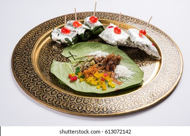 Ingredients of indian traditional digestive meetha masala paan which is a mouth freshener and digestive. Sauf, tutti frutti, supari, clove, gulqand, coconut powder etc added  in Betel leaves & chewed