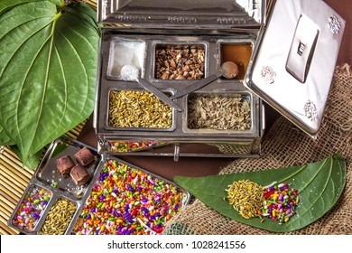 Ingredients of indian traditional meetha masala paan which is a mouth freshener and digestive. Sauf, tutti frutti, supari, clove, gulqand, coconut powder etc added in Betel leaves & chewed. Pandaan.