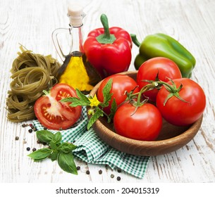Ingredients for Italian pasta on a wooden background