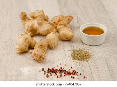 Ingredients for Jerusalem artichoke chips on wooden background