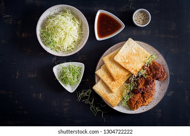 Ingredients for Katsu Sando - food trend japanese sandwich with breaded pork chop, cabbage and tonkatsu sauce. Japanese cuisine. Top view