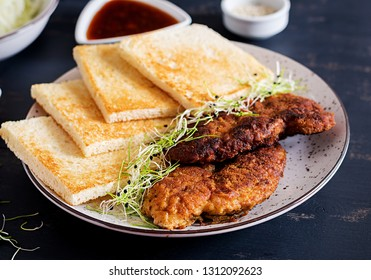 Ingredients for Katsu Sando - food trend japanese sandwich with breaded pork chop, cabbage and tonkatsu sauce. Japanese cuisine.