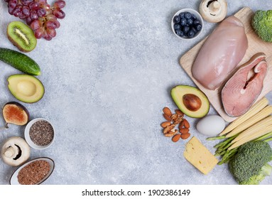 ingredients for a ketogenic diet on a gray background: chicken, fish, vegetables. view from above. copy space