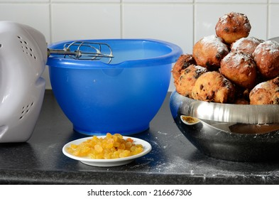 Ingredients like raisins and a hand mixer for baking oliebollen, oil balls or donut balls, a dutch pastry traditionally eaten on New Year's Eve in the Netherlands.