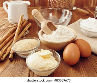 Ingredients to make a cake or a dessert on an aged wooden table