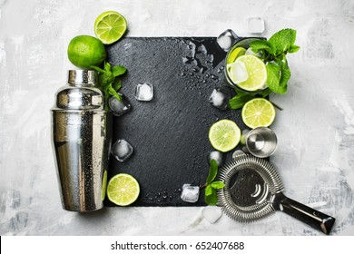 Ingredients for making alcoholic summer cocktail and bar tools, drink background, top view
