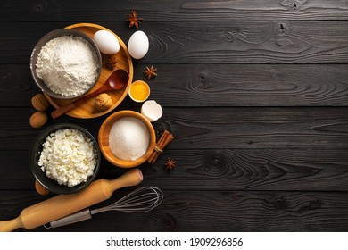 ingredients for making buns with cottage cheese on a wooden background, top view, place for text
