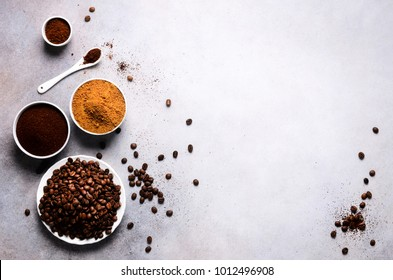 Ingredients for making caffeine drink - brown coconut sugar, coffee beans, ground and instant coffee on light concrete background, copy space, top view. Banner.