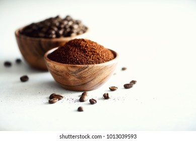 Ingredients for making caffeine drink - coffee beans, ground and instant coffee on light concrete background, copy space. Banner.