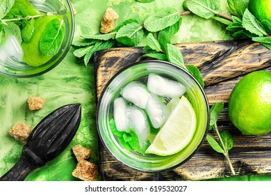 ingredients for making mojito,mint leaves,ice cubes,lime and brown sugar