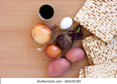 Ingredients for making the Passover traditional foods with matzo bread and glass of red wine on a tabletop