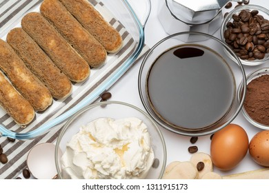 Ingredients for making traditional italian cake tiramisu on white background