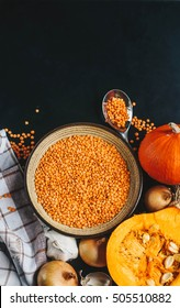 Ingredients for making vegetarian pumpkin-lentil cream  with garlic and onion. Top view, copy space