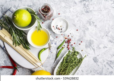The ingredients for marinating meat before baking or grilled skewers for easy summer family picnic lunch. Olive oil, balsamic, soy, garlic, salt, pepper, rosemary, lemon marinade. selective Focus