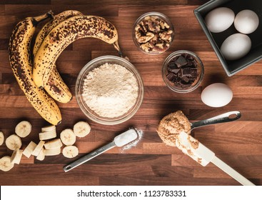 Ingredients for Paleo grain and sugar free banana bread with walnuts and dark cocoa
