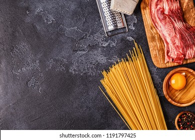 Ingredients for Pasta Carbonara on dark background, top view.