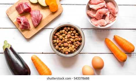 ingredients for pet food holistic top view on wooden background