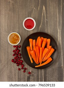 Ingredients for Pickled carrots in cranberry juice on wooden background