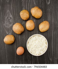 Ingredients for Potato pancakes on wooden background