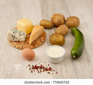 Ingredients for Potatoes and zucchini in three cheese sauce