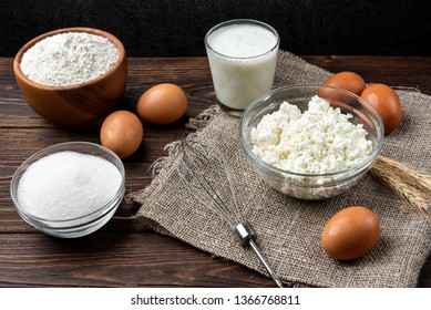 Ingredients for preparation cottage cheese pancakes. Cottage cheese, eggs, sugar, milk and flour.