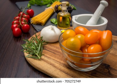Ingredients for the preparation of pasta isolated on wooden background. Culinary layout.