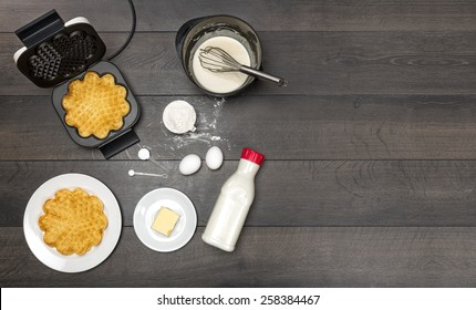 Ingredients, preparation and serving of waffles. All ingredients needed for waffles. Copy space included.