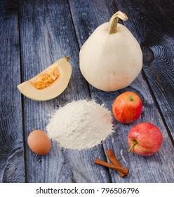 ingredients for Pumpkin and apple pancakes on wooden background