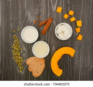 Ingredients for Pumpkin cream on wooden background. Photograph taken from above.