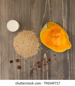 Ingredients for Pumpkin and pearl barley porridge with bacon on wooden background