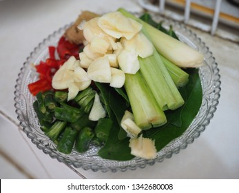 Ingredients ready to cook consist of red and green chili, daun salam (bay leaf), lemongrass, garlic, jahe (ginger), daun jeruk (lime leaves) and onion. Top view close up detail.