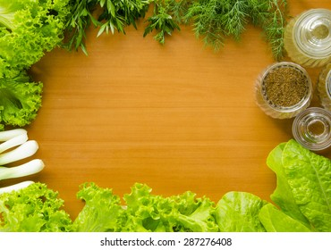 Ingredients for a salad on a wooden table