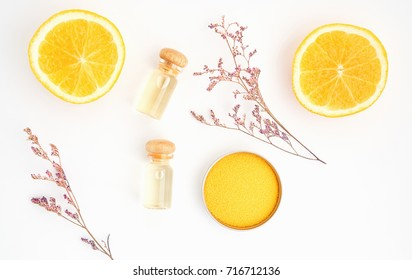 Ingredients of skin care products. And honey in the glass, Blank label package for mockup on white background and flowers. The concept of natural beauty products.