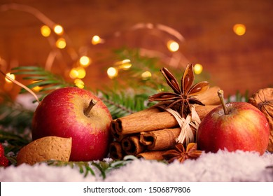 Ingredients and spices for christmas bakery   -  Almond, cinnamon sticks, apple, star anise  decorated with christmas cookie in snow