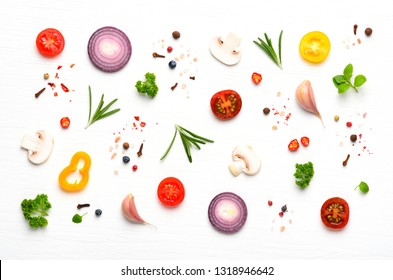 Ingredients and spices for cooking homemade pizza on white wooden background. Copyspace. Top view.
