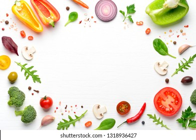 Ingredients and spices for homemade pizza on white wooden background. Top view .