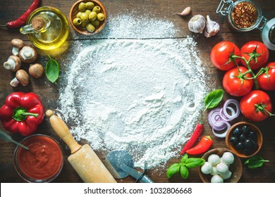 Ingredients and spices for making homemade pizza. Top view with copy space on wooden table  - Shutterstock ID 1032806668
