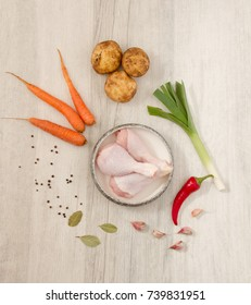 Ingredients for Spicy chicken soup on wooden background (photo from above)
