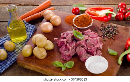 Ingredients for stew or goulash  on a cutting board. Top view