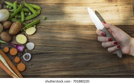 Ingredients for summer soup and woman holding knife. Copy space available.