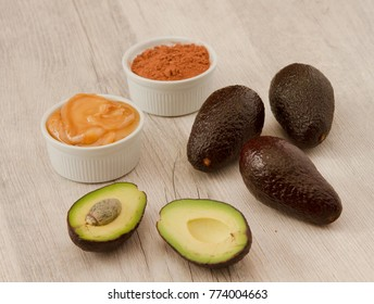 ingredients for Sweet avocado creme for toasts on white wooden background