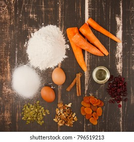 Ingredients for Sweet carrot cake on wooden background