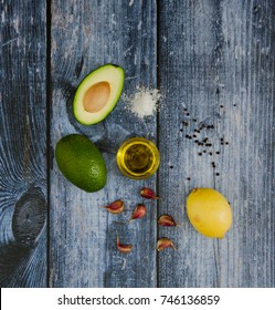 Ingredients for tasty avocado sauce on wooden background