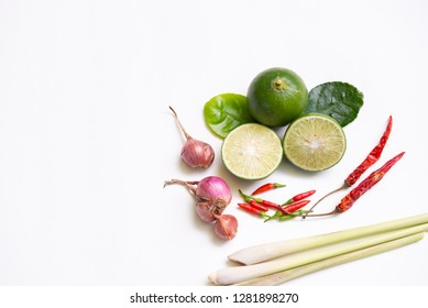 """Ingredients of Thai spicy food """"Tomyum"""" spicy soup. lemon, chilli, Red onion, lemon grass, Kaffir, lime leaves. Top view, copy space."""