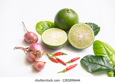 "Ingredients of Thai spicy food ""Tomyum"" spicy soup. lemon, chilli, Red onion, lemon grass, Kaffir, lime leaves. Top view, copy space."