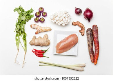 ingredients of a thai tom kha gai soup on white