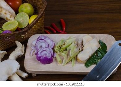 ingredients of TomYam spicy was cut with a knife put on Wood chopping board and in the basket.At on a wooden table.